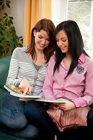two women looking at a shopping catalog