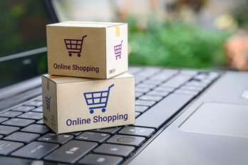 online shopping boxes on a laptop computer